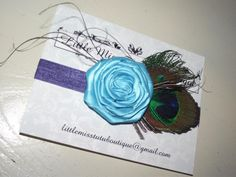 I am loving the new peacock-inspired headbands. They are beautiful!!! :)