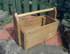 """This item is based on a vintage design of a traditional country tool box. It features handle supports with an attractive gothic arch profile and has an in-built holder for screwdrivers. It measures 15(L)""""x9""""(W)x7""""(H) approx. and the standard box is stained and finished with beeswax. Alternatively, the box can be painted in any colour, to order."""