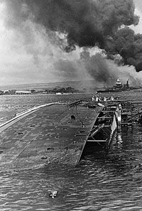 The USS Oglala capsized at Pearl Harbor after being hit by Japanese aircraft, December Smoke billows from other damaged and destroyed American ships in the background. Photo courtesy of National Archives and Records Administration Pearl Harbor 1941, Pearl Harbor Day, Pearl Harbor Attack, Uss Helena, Day Of Infamy, Remember Pearl Harbor, Uss Arizona Memorial, Navy Ships, Time Photo