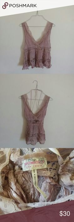 FREE PEOPLE Lace Top Authentic Free People lace top in Dusty Pink. Size XS with a very giving cut. Second picture depicts hanger attachments- these are not to be worn** Free People Intimates & Sleepwear Chemises & Slips