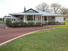 Weatherboard colonial house exterior with balustrades & hedging Weatherboard House, Queenslander, Colonial House Exteriors, House Front Porch, Storey Homes, Facade House, Home Reno, Cladding, Fixer Upper