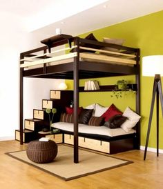 Lofted bed with seating area underneath. Would be great for a teenage boy/girl room.  Or for kids who share a room to have their own space