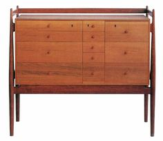 Finn Juhl, chest of drawers. Only 5 were made in 1949. Made by Niels Vodder / Hansen & Sørensen. Made of Burna Teak, Pine & Maple.