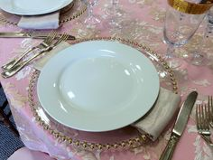 Clear glass gold beaded charger, ivory rimmed china, gold Savoy flatware, & champagne shimmer napkins.