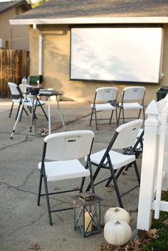 Halloween Driveway Party - set up chairs in front of projector to show a Halloween movie!