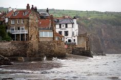 Robin Hood's Bay is a small fishing village and a bay located within the North York Moors National Park, five miles south of Whitby and 15 miles north of Scarborough on the coast of North Yorkshire, England. The town, which consists of a maze of tiny streets, has a tradition of smuggling, and there is reputed to be a network of subterranean passageways linking the houses. Wikipedia