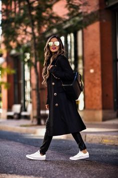 "OCTOBER 23RD, 2017 BY MARIA 5 Key Pieces For Off-Duty Fall Style - OUTFIT DETAILS: Free People Sweater Calvin Klein Double-Breasted Trench Coat Joe's Coated Skinny Jeans Tommy Hilfiger ""TH"" Twist Backpack Similar Gold Aviator Sunglasses Converse Chuck Taylors"