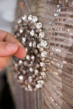 Fashion in the making - close up of a beautifully sequinned couture dress being made... behind the scenes at Elie Saab; fashion atelier