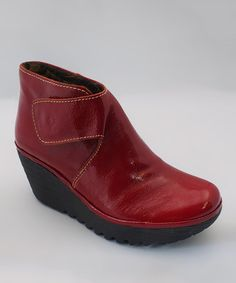 These I find oddly cute. Dunno why... #zulily! Red Your Patent Leather Wedge Bootie by FLY London #zulilyfinds