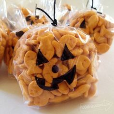 Perfect non sugar treat Plus makes a great party activity... Kids decorate their own bag and then fill with goldfish. Happy Pumpkin Halloween Treat