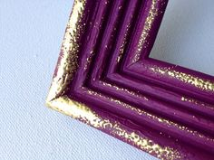 A little gold embossing freshens up an upcycled frame at this Etsy shop. Neat idea.
