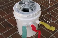 DIY Portable Bucket Air Conditioner eHow cheap small fan gallon of frozen water etc easy Bucket Air Conditioner, Camping Air Conditioner, Homemade Air Conditioner, Dog House Air Conditioner, Homestead Survival, Camping Survival, Camping Hacks, Camping Ideas, Camping Supplies