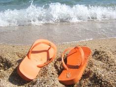 ...sandy orange flip flops...