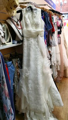 Size 12 vintage-esque Wedding Dress with Collar Detail from Mind Charity Shop in Harrow.