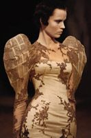 Alexander McQueen (British, 1969–2010) Dress Sarabande, spring/summer 2007 Cream silk satin and organza appliquéd with black degrade silk lace and embroidered in clear beads and sequins.