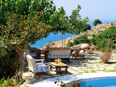 Rethymno villa rental - Sitting area under the shade on the terrace! Crystal Clear Water, Sitting Area, Terrace, Swimming Pools, Villa, Patio, Beach, Outdoor Decor, Living Room