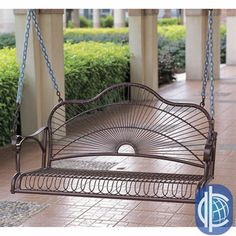 International Caravan Sun Ray Iron Porch Swing, with outdoor pillows from the Basket Bunch