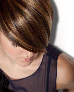 Caramel highlights on brunette hair.