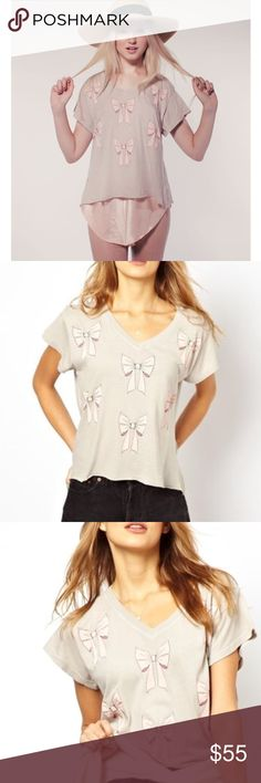 """Wildfox Natural Little Bows Grandma Tee Wildfox v neck casual tee. Front is higher than back. So cute. EUC with a ton of life left. Name written on tag as shown in photo. Taupe and pink. Armpit to armpit approx 19.5"""" Wildfox Tops Tees - Short Sleeve"""