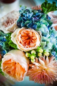 peach and blue bouquet - garden roses, dahlia, hydrangea shot by Amanda Hein.
