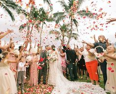 Throw kindness around like petal confetti! Photo by Anna Kim Photography of an epic rose petal confetti toss over the newlyweds (wedding by White Orchid Wedding, florals by Dellables)