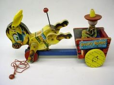 1955-57 issue.  Donkey cart has large wooden yellow wheels on rear and red wheels on front.    Courtesy: GASOLINE ALLEY ANTIQUES, Antique Toys & Collectibles, SEATTLE, WA (USA).