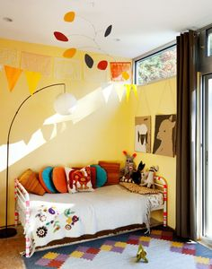 Vintage Toddler Bedroom; Welo's room has the same color wall paint.  I like the pops of bright color to add some personality.