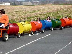 Stella and Ashima on the Barrel Train Barrel Train, Kids Play Equipment, Drum Chair, Oil Barrel, Trains For Sale, Steel Barrel, Harley Davidson, Farm Tools, Kids Play Area