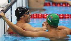 Michael Phelps, left, celebrates after winning his 21st career medal, beating South Africa's Chad le Clos, right, in the 100-meter butterfly final.