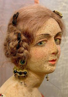 Faded beauty: a vintage (circa 1920s-1930s) Lenci boudoir doll with water damage freckles. She has human hair and a painted stockinette face.Photo credit: Kathy Libraty