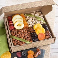 Golden State Fruit Pacific Coast Classic Dried Fruit Tray Gift - An assortment of popular dried fruits with fresh almonds and pistachios in-the-shell, arranged to perfection in charming wooden tray with carved handles. Dry Fruit Tray, Dried Fruit, Yogurt, Fruit Gifts, Christmas Gift Baskets, Edible Arrangements, Food Platters, Health Desserts, Creative Food