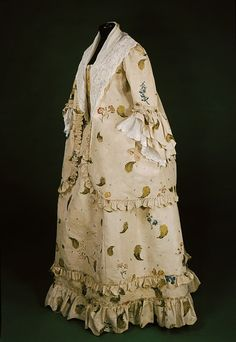"""Pet-en-lair ensemble ca. 1760-1769 via The Victoria  Albert Museum """"This ensemble represents a popular style of informal dress for women in the 1760s. Known by the French name 'pet-en-l'air', it comprises a short jacket in the style of a sack-back gown worn over a petticoat. The silk is very unusual, bearing three different methods of decoration: weaving, embroidery and paint. """""""