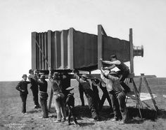 Largest Camera in the World - circa 1900: In 2 1/2 months, manufacturerJ.A. Andersonof Chicago produced a mammoth camerawith the following specifications: Size of glass negative: 8' x 4 1/2' feet! - Length with bellows extended: 20' - Length with bellows folded: 3' - Weight: 1,400 lbs - Number of operators: 15 - Exposure time: 2 1/2 min.