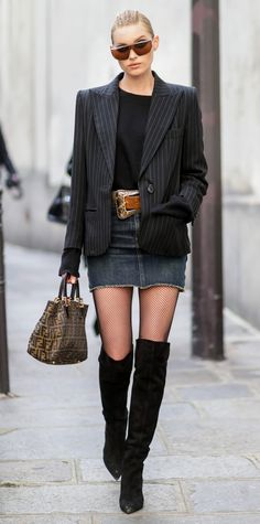 Elsa Hosk = the ultimate cool girl in this badass ensemble. The model paired a menswear-inspired jacket with a denim miniskirt and dressed it up with fishnet tights, OTK boots, an oversized western belt, vintage Fendi bag, and sharp sunnies.