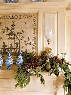 A pinecone-and-evergreen string of garland spices up this mantelpiece for the holidays. With white berries and a bit of ribbon, this natural accent gets a bit of elegance. (Photo: Tria Giovan)