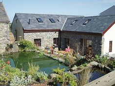 converted barn AND a natural pool. perfect. also for rent for vacation in the UK.