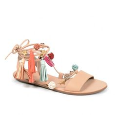 Leather sandals with pom and tassel embellishments