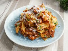 Get Fresh Pasta with 20 Minute Sausage and Beef Bolognese Sauce Recipe from Food Network. Made Used dry ziti because I did not have fresh pasta. Pasta Recipes, Beef Recipes, Cooking Recipes, Recipies, Dinner Recipes, Cooking Fish, Cooking Pork, Healthy Recipes, Italian Dishes