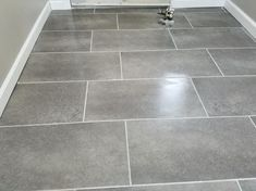 TrafficMASTER Ceramica 12 in. x 24 in. Coastal Grey Resilient Vinyl Tile Floorin… TrafficMASTER Ceramica 12 in. x 24 in. / – The Home Depot Best Vinyl Flooring, Vinyl Flooring Bathroom, Luxury Vinyl Tile Flooring, Bathroom Vinyl, Kitchen Vinyl, Vinyl Tiles, Basement Flooring, Bathroom Floor Tiles, Bedroom Flooring