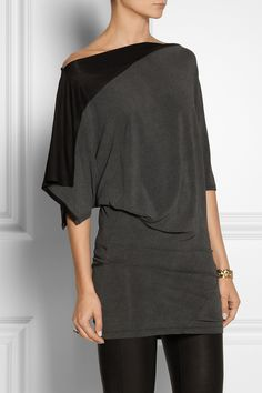 DONNA KARAN | Modern Icons Draped Jersey Top. When it comes to more Casual everyday pieces, Donna Karan still works with luxurious fabrics and the Expert draping skills used in her Coveted Evening Gowns. This Gray and Black top is made from liquid-like jersey that Beautifully falls across the body.