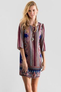 "A pretty print makes the Alvarado Printed Shift Dress extra special.  A colorful scarf print decorates this simple shift silhouette with a tie in the back. Style with heels & a satchel for a finished look.<br /> <br /> - 33"" length from shoulder to hem<br /> - 38"" chest<br /> - 41"" sweep<br /> - measured from a size small<br /> <br /> - 100% Polyester<br /> - Hand Wash<br /> - Made in U.S.A."