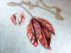 This is a necklace and earring set I made for the National Roofing and Contractors Association.  It is made from recycled roofing copper which has been heated, sawed, and hammered into leaf shapes.  Taking special orders now.