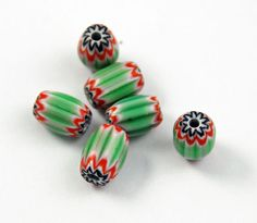 Green white red and black chevron beads