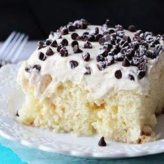 Cannoli Poke Cake - vanilla cake topped with cannoli filling icing!