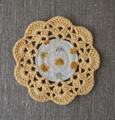 A teapot/mug cosy - padded fabric centre, crochet edge. I love it!
