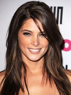 Ashley Greene hairstyle with a deep side part and long layers   allure.com