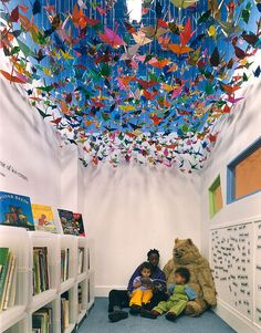 I did this once in my boys room, but made a sea of fish instead!!  This would look super amazing in a classroom to!  Lisa Leray xoxox