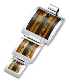 #Colgante de #plata y #ámbar multicromático. Esta preciosa composición de plata y trozos de ámbar de distintos colores se convertirá en tu #joya favorita. De www.ekleipsis.com