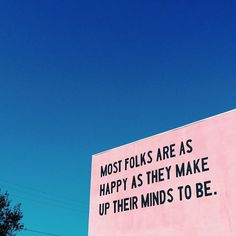 most folks are as happy as they make up their minds to be - street art