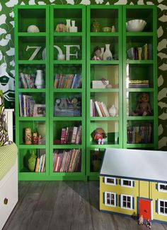 """Big Green Bookcase: To accommodate Zoe's huge collection of books, ready-made bookcases were assembled, then installed on the right wall of the room, a few feet from Zoe's daybed."" [From ""Girl's Nature-Inspired Bedroom"" -- more photos at click-through and another shot here: http://pinterest.com/pin/175218241724770717/]"